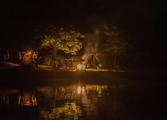 camping by the lake (tibchris) Tags: camping night evening campfire lake reflections alone california snapchris dark trees boating