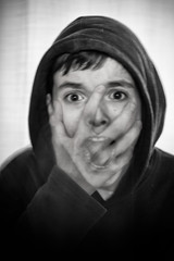 Scary (le cabri) Tags: longexposure portrait bw white man black mouth hoodie scary long exposure expression young scream teenager openmouth effraid