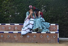 Osuna, Spain (LidyvN) Tags: park girls two rose feast bench spain girlfriend fiesta dress dancing spanish frock andalusia ropa fria