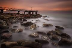 The pier (Anto Camacho) Tags: longexposure castellon xilxes chilches bigstopper largaexposicion pier sunshine spain sea mediterranean foam rocks