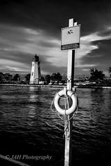 Across The Dark Waters (jah32) Tags: water portdalhousie lighthouse ontario canada lifepreserver wellandcanal blackandwhite blackwhite cmwdblackwhite bw cmwdbw mono monochromatic