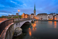 Fraumunster Church and Limmat River in the Morning, Zurich, Switzerland (ansharphoto) Tags: architecture bell blue bridge capital cathedral church city cityscape clock dark dawn embankment europe european fraumuenster fraumunster historic history house illuminated landmark lights limmat medieval morning munster munsterbrucke night old railing river sky skyline spire street suisse swiss switzerland tourism tower town traditional travel twilight urban vacation water zuerich zurich