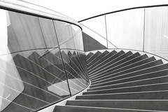 East meets West (ohank1951) Tags: curve curves line lines bw blackandwhite monochrome noiretblanc black white geometrie geometry composition abstract minimal stairs stair glass reflection shadows design interior architecture architectuur indoor domesticarchitecture zwolle museum fundatie museumdefundatie architecthubertjanhenket hubertjanhenket biermanhenketarchitecten biermanhenket netherlands nederland canoneos1100d ef24105mmf4lisusm