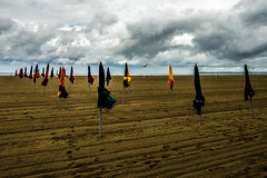 mauvais temps pour les parasols (M@J.) Tags: mer france sable normandie nuage cherbourg parasole