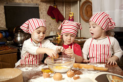 Three Little Chefs Enjoying In The Kitchen Making Big Mess. Little Girls Making Bread In The Kitchen (caterina.christakos) Tags: family girls friends red people food color cute home cooking kitchen beautiful cookies childhood smiling horizontal kids children bread fun person baking toddler funny uniform mess pretty baker child little dough interior cook happiness dirty 45 apron chef bakery eggs leisure mixing cheerful flour making preparation preparing lifestyles