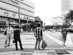 Pedestrian's Gamble | KL Street Nightwalk.03 (Johnragai-Moment Catcher) Tags: street people blackandwhite bw john blackwhite streetphotography streetlife olympus malaysia slowshutter kualalumpur omd slowshutterspeed monocrome ragai streetmoment malaysiastreet klsp momentcatcher kualalumpurstreet johnragai omdem1 johnariragai mzuikodigitaled1240mmf28pro johnragaiphotos omdsp klstreetphotographers omdstreetphotography pedestriansgamble