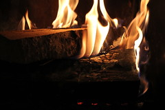 Hot Flames (bigbrowneyez) Tags: wood light hot cold beautiful reflections flow fire gold design movement fireplace pretty camino shimmery patterns flames smooth textures heat romantic lovely fabulous freddo cuddling artful fuoco flicker oro swaying bello caldo bellissimo cozzy hotflames