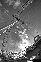 Under the Eye (trevorfrenchphotography) Tags: sky blackandwhite london monochrome westminster sunshine wheel architecture photography curves engineering londoneye streetlife tourist structure southbank lookingup ferriswheel cloudporn structural theeye streetview sunnyday blackandwhitephotography wintersun lookingthrough straightlines placestogo awesomeskies amazingplaces canon5dmk3