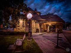 Quarter to Nine (brianloganphoto) Tags: rail flowers warwick cloudy brick buildings clock evening clouds railroadavenue trees ny historical stores bluehour orangecounty commerical transportation landcape sky newyork street village railroadgreen railroad landmark