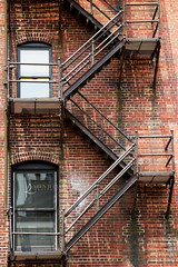 116in2016 #6 diagonal (Karen Juliano) Tags: reflection building brick window stairs platform rusty denver fireescape blinds 116in2016