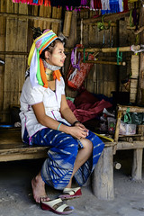 A Young Kayan Lahwi Girl (Anoop Negi) Tags: kayan lahwi padaung burma tribe thailand chiangmai culture long neck brass rings persecution tourism thai girl woman colorful dress photo photography anoop negi ezee123