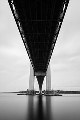 Low Angle (Amar Raavi) Tags: nyc newyorkcity longexposure bridge blackandwhite bw usa ny newyork water monochrome brooklyn sunrise dawn unitedstates lookingup pointofview statenisland longest suspensionbridge verrazanobridge lowangle verrazanonarrowsbridge thenarrows fortwadsworth lowpov giovannidaverrazzano
