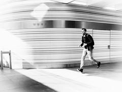 in hurry (Rien van Voorst) Tags: streetphotography straatfotografie blackandwhite monochrome urban city thenetherlands highkey