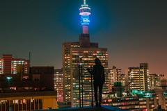 Hillbrow (elsableda) Tags: hillbrow cityscape nightscape neon lights light telkom buildings architecture brutalist view johannesburg joburg southafrica africa girl self portrait windows