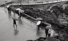 Kiama blow hole (oh_jon) Tags: grii gr ricoh blowhole landscape bw blackandwhite umbrella rain australia kiama people