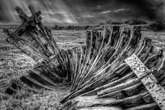 There be a storm ahead (Caleb4ever) Tags: caleb4ever boat bw hdr shipwreck storm skeleton stormysky