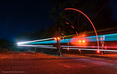 Northbound XPT going past crossing.. (Photography By Tara Gowen) Tags: train night lighttrails lights railcrossing red blue boomgates longexposure nikon australia xpt eungai stars traintracks tokina1116mm thisisexcellent