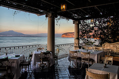 Restaurant View (Jenny Pics) Tags: view scenery lighting fence water mountains restaurant chairs tables reflections sorrento italy blue hff
