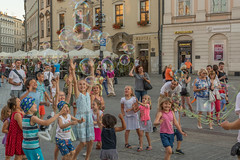 summer joy (stevefge) Tags: krakow poland summer zomer people candid boys girls children kinderen kids bubbles playing play oldtown squares reflectyourworld
