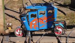 A Mototaxi crosses the rails - Peru (WanderingPhotosPJB) Tags: blue peru mototaxis rails tuktuk autorickshaw colours multicoloured