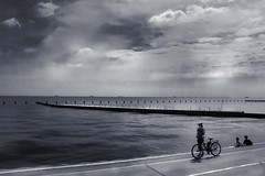 Stop the time (Explore #137 Feb 16 2015) (ogi75) Tags: light sky people blackandwhite lake beach water bicycle clouds dark horizon drama