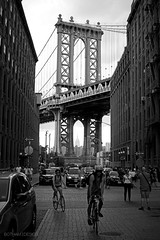 New York City | DUMBO Cityscape 01 (Christopher James Botham) Tags: nyc newyork newyorkcity brooklyn bridge manhattanbridge river fiverfront city cityscape urban street streetscape dumbo hudson hudsonriver structure structural truss suspension suspensionbridge