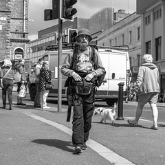 The Traveller (Howie Mudge LRPS) Tags: man male person walk walking towncenter people men women dog van road line shadows light bright sunny day outside outdoors buildings windows doors hat devon torquay england uk street streetphotography streetlife urban urbanphotography blackandwhite blackwhite bw mono monochrome sony rx100iv compactcamera travel travelling