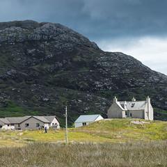 Quick, Get the washing in! (baltibob) Tags: clouds hebrides hills mountains outerhebrides remote rocks storm washing weather housing lochboisdale scotland unitedkingdom