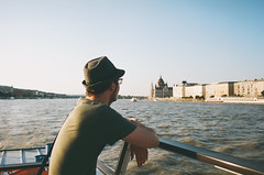 Donau (Kathleen Vtr) Tags: light sunset summer portrait sunlight holiday man film water beautiful hat sunshine analog 35mm river photography gold back cityscape budapest bluesky traveller explore lover canonae1 danube discover donau goldenlight kodakportra citytravel