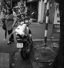 Telephone conference (Marc Molenaar) Tags: oldquarter day motorbike rest calling man monochrome bw blackwhite blackandwhite street streetlife leicaq tired sloth