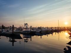 Sunrise at Harbor Hill Marina (Ralph Cherubin) Tags: olympus epm2 panasonic 14mmf25 sunrise niantic connecticut ct eastlyme boat marina water reflection july 2016