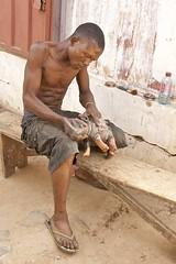 Sanding a rhino (Pejasar) Tags: rhino carving craftsman worker man shirtless accra market ghana westafrica africa