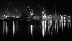 Shipyard monochrome (Budoka Photography) Tags: le longexposure mirror blackandwhitephotos bw blackandwhite monochrome shipyard water waterscape sonyalphailce7rm2 sonysel1635f4 wideangle nightphoto night