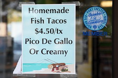 Homemade fish tacos with north-of-the-border artwork, Port Chester, New York (Eating In Translation) Tags: westchestercounty portchester translation signage grocersandmarkets