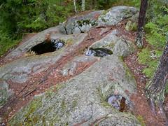 A group of potholes (giant's kettles) formed during the Ice Age (Pirttimäki recreation area, Espoo, 20111127) (RainoL) Tags: november autumn rock espoo finland geotagged u fin nuuksio pothole uusimaa nyland 2011 esbo pirttimäki 201111 20111127 geo:lat=6026178500 geo:lon=2461670000
