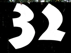 Thirty Two (Steve Taylor (Photography)) Tags: wood newzealand christchurch white house black contrast fence wooden canterbury richmond number nz southisland stark 32 thirtytwo redzone