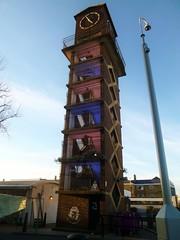 the Clock Tower at Chrisp Street, London (helenoftheways) Tags: london uk buildings clocks clocktower blue pink chrispstreet poplar freeassociation
