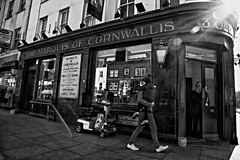 The Marquis of Cornwallis, Pub, Bethnal Green, London, East End - IMG_2686-Edit (roger_thelwell) Tags: life street city uk winter portrait england people urban bw white black streets cold london lamp monochrome beautiful beauty hat rain leather mobile umbrella hair walking real photography mono pub chat shiny phone traffic post natural photos britain circus cigarette candid great over hats cell photographic smoking lamppost photographs oxford conversation shiney talking shoulder handbag stud speak speaking studs commuters marquis stylish boozer eastend bethnalgreen cornwallis stunningly withlensflare themarquisofcornwallis