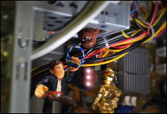 Repairing the Millennium Falcon (Mindless Philosopher) Tags: toy starwars nikon collectible chewbacca c3po hasbro hansolo theempirestrikesback galacticheroes nikond90 jediforce