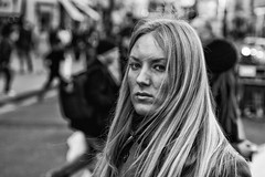 A stern looking blonde girl - IMG_2074-Edit (roger_thelwell) Tags: life street city uk winter portrait england people urban bw white black streets cold london lamp girl monochrome westminster beauty hat rain leather mobile umbrella hair bag walking real photography mono chat shiny phone looking traffic post natural photos britain circus cigarette candid cab taxi great over sac hats cell photographic smoking lamppost photographs oxford blonde conversation shiney talking shoulder stern handbag stud speak speaking studs commuters a scak