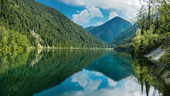 Panorama14 (giraffes_fly) Tags: trees summer lake mountains reflection nature clouds forest landscape purple outdoor sunny bluesky symmetry mountainlake kazakhstan kolsay