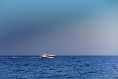 Follow that light (Fnikos) Tags: sky skyline light sea water seascape boat speed vehicle serene outdoor