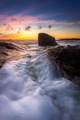 Sunset Flow (Arvid Bjrkqvist) Tags: ocean sunset sea sun colors clouds reflections evening coast rocks waves wind sweden vivid varberg bua