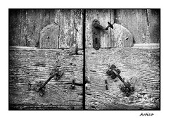 The old entrance (Artico7) Tags: door wood old blackandwhite bw italy detail abandoned monochrome lost handle blackwhite wooden rust iron fuji steel grain rusty symmetry scraped biancoenero ruined friuli polcenigo xe1 wroughtsteel