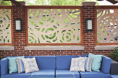 Greenview4 (Chicago Roof Deck and Garden) Tags: outdoor roof deck garden diecut panels metal swirls curved furniture pillows lighting fans