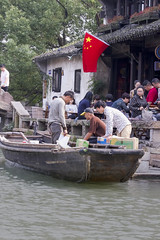 _MG_4047 (almei) Tags: china people building water river boat flag wuzhen watertown waterway