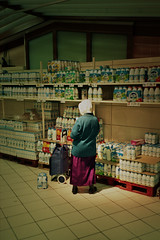 (michel nguie) Tags: michelnguie film analog milk lactel gantcasino vertical roubaix rbx flashless woman caddie granny old supermarket bottles milkpack