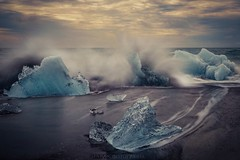 Breaking the ice (Blai Figueras) Tags: islandia sky agua seascape water fiord horizon landscape amanecer atmosphere coast hielo sunrise seaside longexposure le iceberg sea beach sand paisaje flickr playa paraiso splash energia ice iceland costa cielo energy mar clouds silkeffect wow