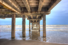 Down Under (mazzmn) Tags: hcs pier cement hdr sea ocean blue waves clouds under pipes sand beach