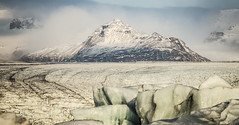 The Mountains and the Glacier (Nick L) Tags: iceland ice glacier mountain landscape jkulsrln jokulsarlon icelagoonatjokulsarlon icelagoonatjkulsrln breiamerkurjkullglacier canon5d3 canon5d 5d 5d3 eos 100400l icebergs moraine
